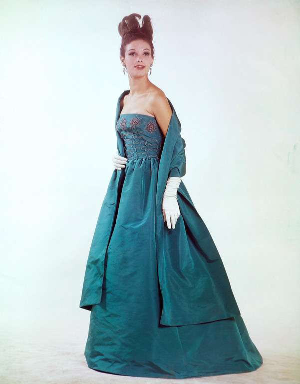 . A gala evening dress of jade green organdy with two large orchids of strass embroidered on the front part, Jan. 14, 1969. (AP Photo/Mario torrisi)