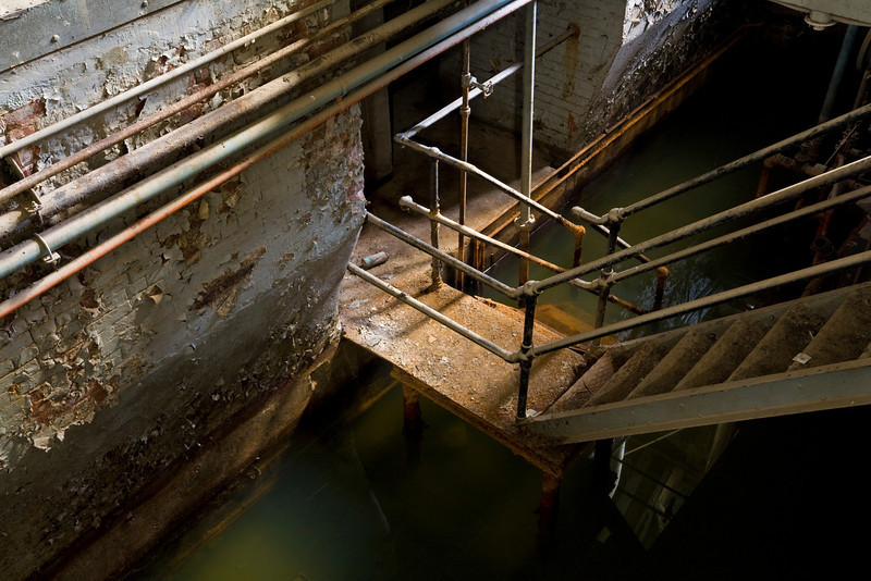 Stairs down to maintenance rooms in the older portion of the engine house during a low-water period; when the house is flooded these stairs are submerged.