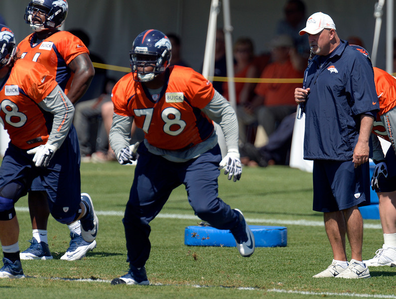 . Denver Broncos offensive line coach Dave Magazu watches Denver Broncos tackle Ryan Clady (78) run through drills during practice August 19, 2013 at Dove Valley (Photo by John Leyba/The Denver Post)