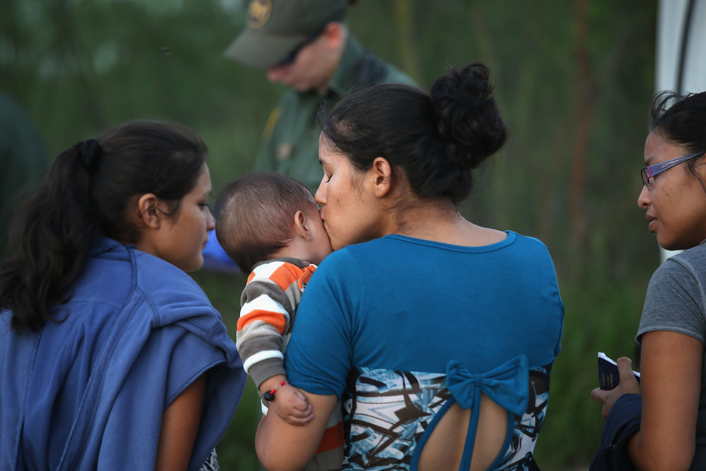 . Families of Central American immigrants turn themselves in to U.S. Border Patrol agents after crossing the Rio Grande River from Mexico on September 8, 2014 to McAllen, Texas.(Photo by John Moore/Getty Images)