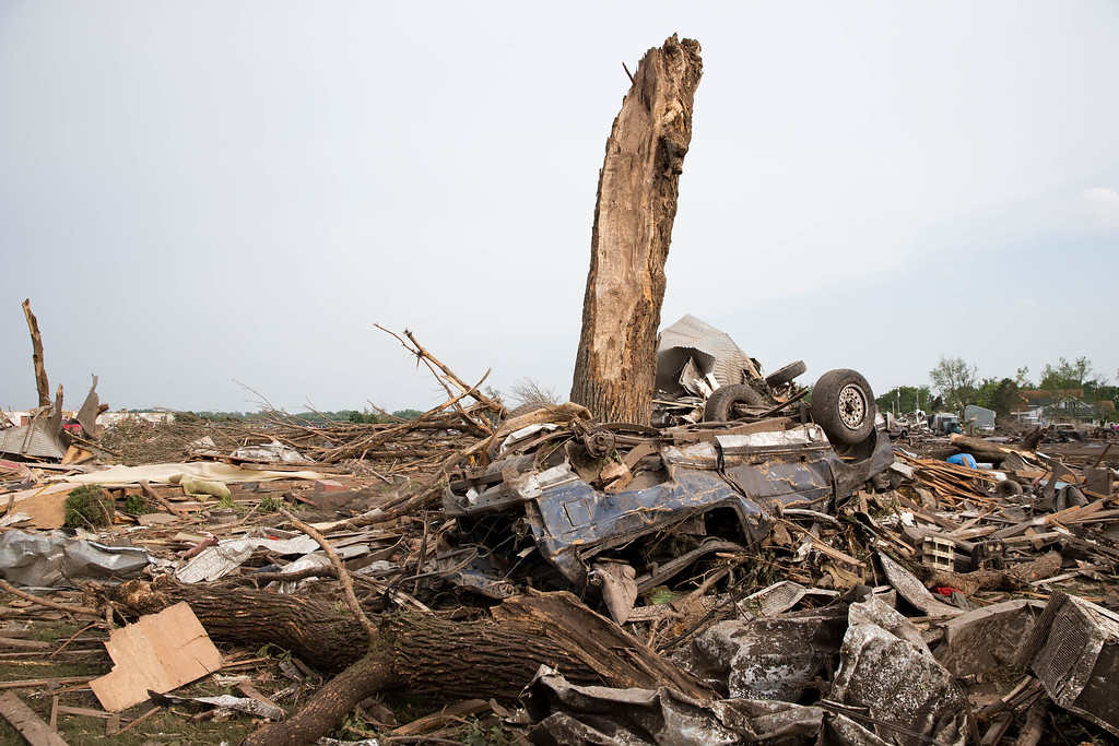 . Debris is scattered along Pilger, Neb., on Monday, June 16, 2014.  The National Weather Service says the storm that struck northeast Nebraska appears to have produced four tornadoes, one of which ravaged the town of Pilger.   (AP Photo/The World-Herald, Ryan Soderlin)