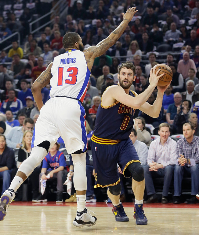 . Cleveland Cavaliers forward Kevin Love is defended by Detroit Pistons forward Marcus Morris (13) during the first half in Game 4 of a first-round NBA basketball playoff series, Sunday, April 24, 2016 in Auburn Hills, Mich. (AP Photo/Carlos Osorio)