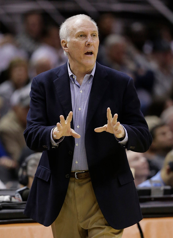 . San Antonio Spurs coach Gregg Popovich gives directions to his team during the first half of an NBA basketball game against the Denver Nuggets, Wednesday, March 26, 2014, in San Antonio. (AP Photo/Eric Gay)
