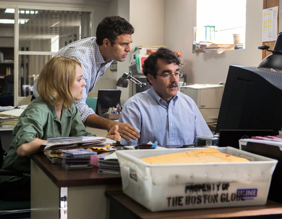". This photo provided by courtesy of Open Road Films shows, Rachel McAdams, from left, as Sacha Pfeiffer, Mark Ruffalo as Michael Rezendes and Brian díArcy James as Matt Carroll, in a scene from the film, ""Spotlight.\"" McAdams was nominated for an Oscar for best supporting actress on Thursday, Jan. 14, 2016, for her role in the film. The 88th annual Academy Awards will take place on Sunday, Feb. 28, at the Dolby Theatre in Los Angeles.  (Kerry Hayes/Open Road Films via AP)"