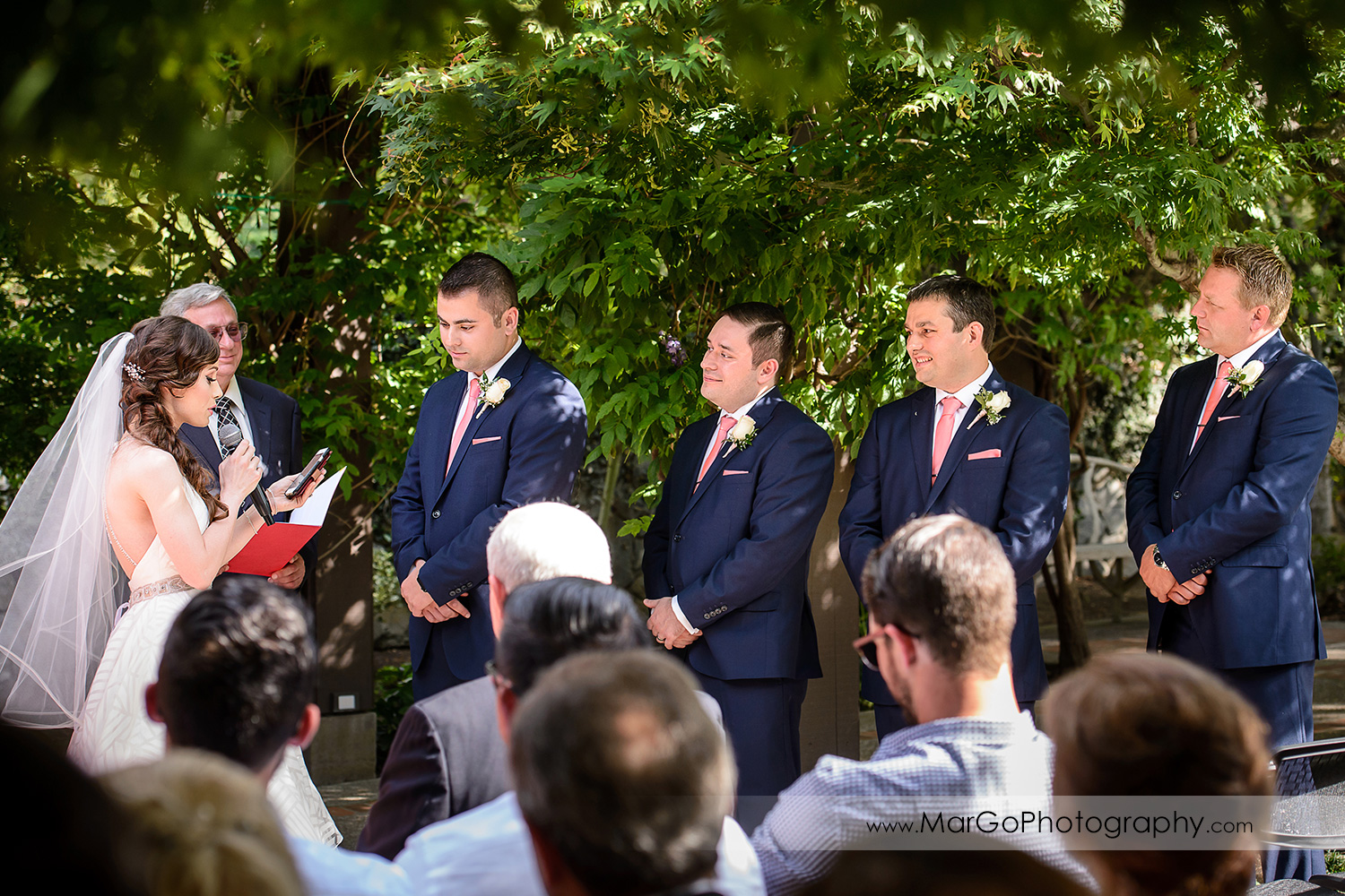 wide view of bride reading vows during wedding ceremony at Saratoga Foothill Club