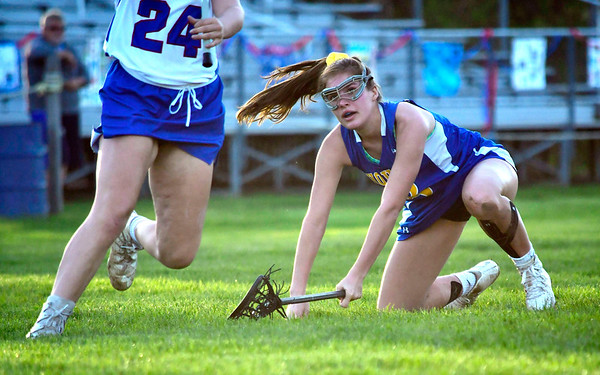 5/8/2019 Mike Orazzi | Staff Housatonic Regional's Genevieve Bushey (8) during Wednesday's girls lacrosse with St. Paul in Bristol.