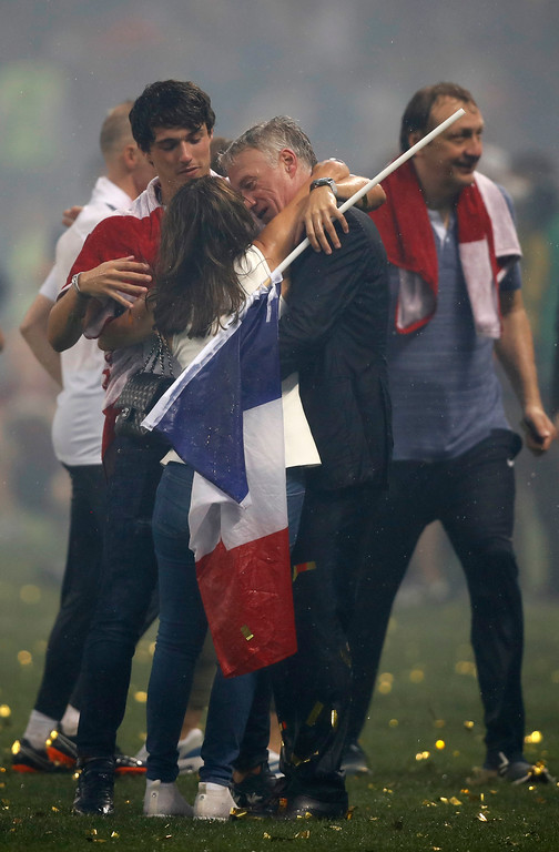 . France head coach Didier Deschamps hugs his wife Claude after the end of the final match between France and Croatia at the 2018 soccer World Cup in the Luzhniki Stadium in Moscow, Russia, Sunday, July 15, 2018.France won the game 4-2. (AP Photo/Francisco Seco)