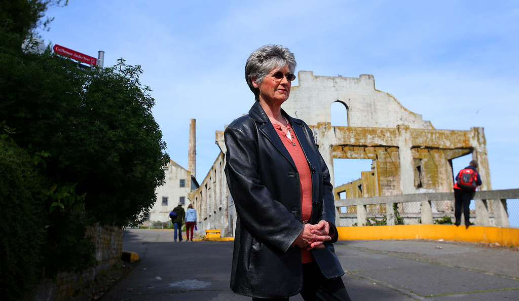 . Former island resident Jolene Babyak is photographed near the officers club on Alcatraz Island on Monday, March 18, 2013 in San Francisco, Calif.  Babyak\'s father was an administration official at the federal prison and her family lived on the island.  The prison closed 50 years ago and the island and prison are now a tourist destination.  (Aric Crabb/Staff)