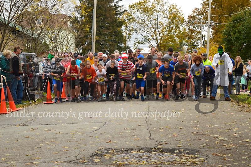 Runners begin the 5K race at the 10th Annual Great Pumpkin Run Sunday in Zelienople. Alex J. Weidenhof/Butler Eagle