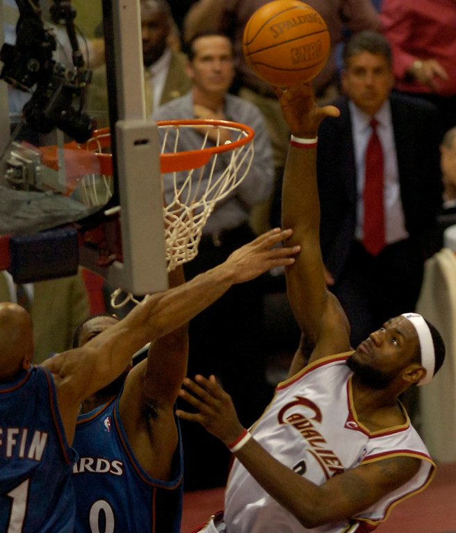 . MORNING JOURNAL/DAVID RICHARD LeBron James makes the game-winning shot in overtime in Game 5 of the NBA playoffs at Quicken Loans Arena.  Defending for the  Wizards are Michael Ruffin, left, and Gilber Arenas.