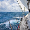 View from onboard luxury sailboat sailing through the tropics.