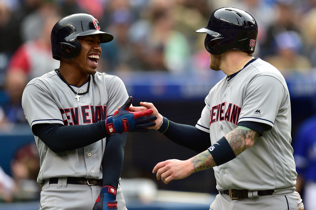 . Cleveland Indians\' Roberto Perez, right is congratulated by Francisco Lindor after scoring a run against the Toronto Blue Jays during the third inning of a baseball game in Toronto, Saturday, Sept .8, 2018. (Frank Gunn/The Canadian Press via AP)