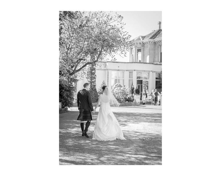 Wedding Photography of Sarah & Brian, Grange Manor Hotel, Grangemouth, Falkirk, Photograph is of the Bride & Groom walking towards the hotel