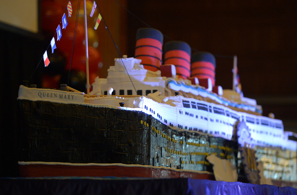 . The Queen Mary celebrated its 80th anniversary of her launching by inviting the public to tour the ship for free in Long Beach, CA on Friday, September 26, 2014. After some speeches and a short film, guests were able to sample a slice of cake from a 15-foot long, 600-pound replica of the ship made by baker Jose Barajas. (Photo by Scott Varley, Daily Breeze)