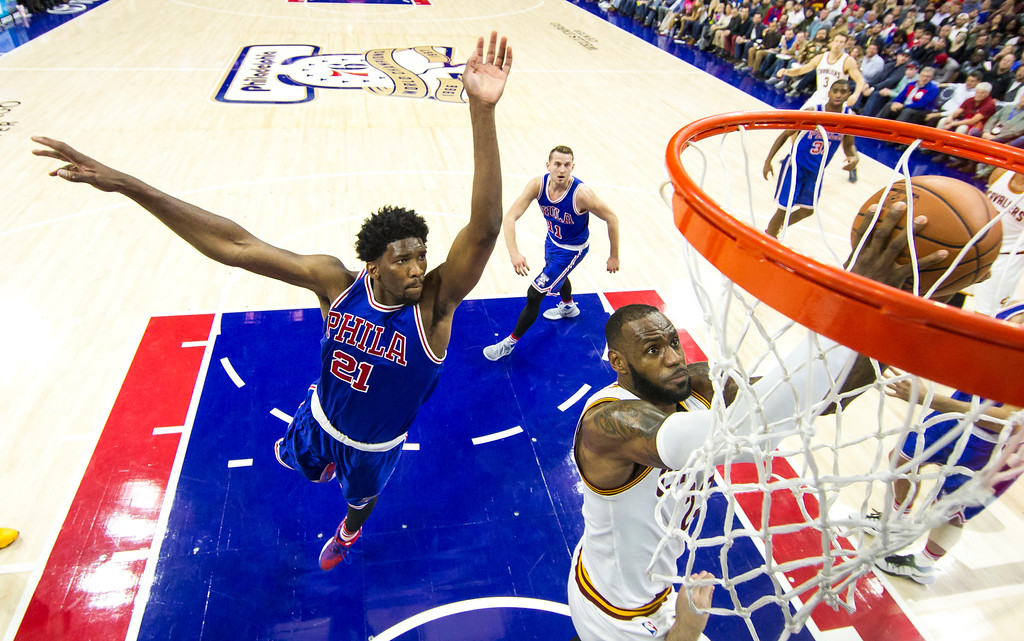 . Cleveland Cavaliers\' LeBron James, right, goes up for the shot as Philadelphia 76ers\' Joel Embiid, left, comes over to block it during the second half of an NBA basketball game, Saturday, Nov. 5, 2016, in Philadelphia. The Cavaliers won 102-101. (AP Photo/Chris Szagola)