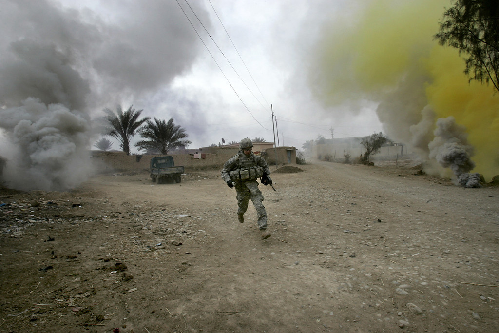 . A U.S. army soldier from Ghostrider Company, 3rd Squadron, 2nd Stryker Cavalry Regiment runs for cover during Operation Phantom Phoenix in the village of Abu Musa on the northern outskirts of Muqdadiyah, in the volatile Diyala province, about 90 kilometers (60 miles) north of Baghdad, Iraq, Thursday, Jan. 10, 2008. (AP Photo/Marko Drobnjakovic)