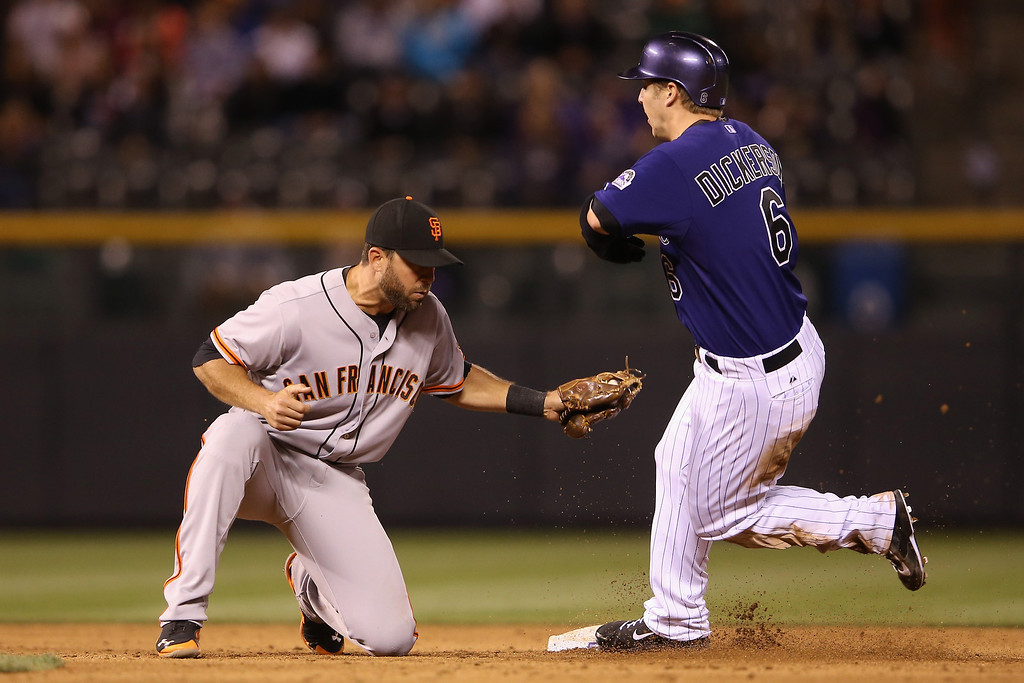 . Corey Dickerson #6 of the Colorado Rockies steals second base as second baseman Brandon Hicks #14 of the San Francisco Giants takes the late throw in the fifth inning at Coors Field on April 21, 2014 in Denver, Colorado.  (Photo by Doug Pensinger/Getty Images)
