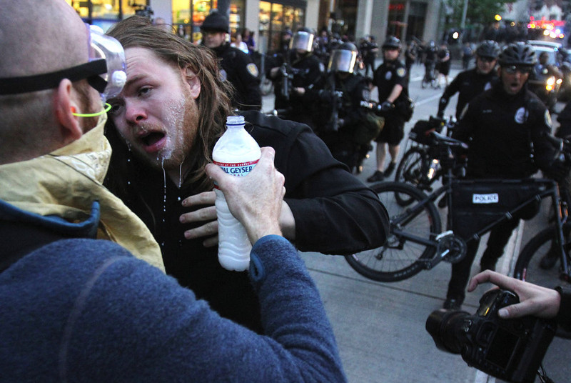 . A Man who was pepper sprayed is attended to during a May Day march that began as an anti-capitalism protest and turned into demonstrators clashing with police Wednesday, May 1, 2013, in downtown Seattle. (AP Photo/The Seattle Times, Ken Lambert)