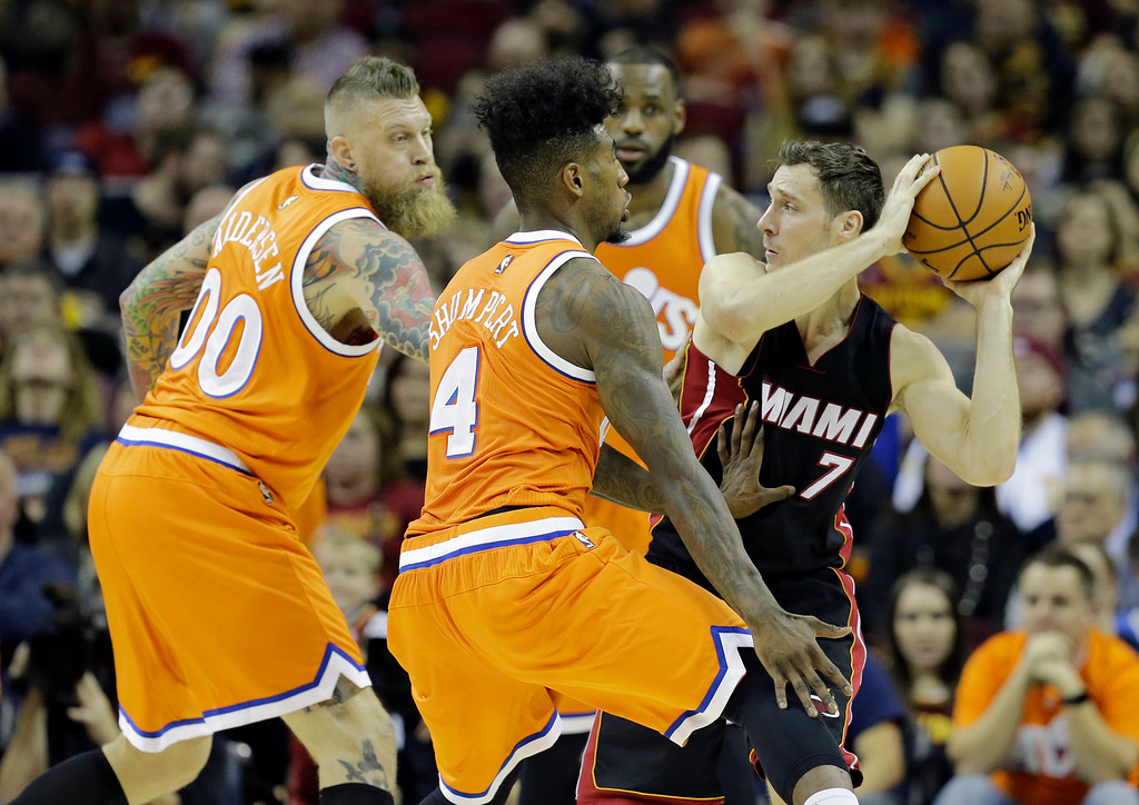 . Miami Heat\'s Goran Dragic (7) looks to pass around the Cleveland Cavaliers in the first half of an NBA basketball game Friday, Dec. 9, 2016, in Cleveland. (AP Photo/Tony Dejak)