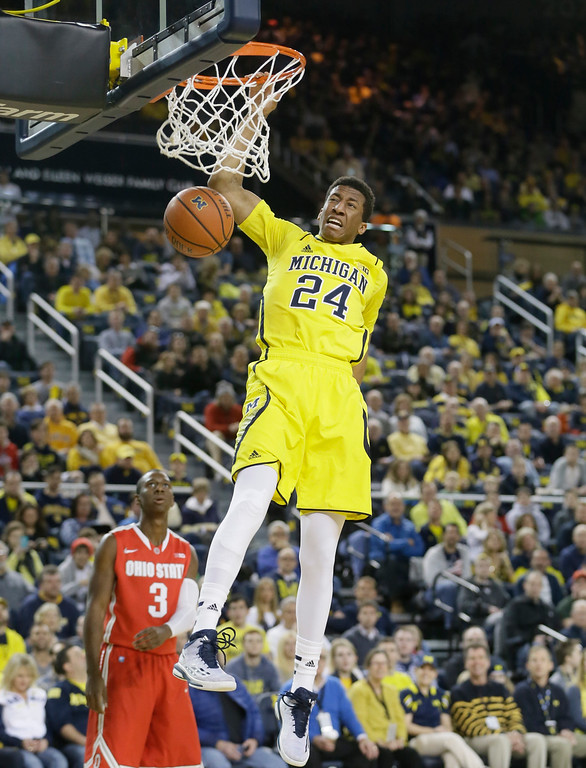 . Michigan guard Aubrey Dawkins dunks during the first half of an NCAA college basketball game against Ohio State, Sunday, Feb. 22, 2015 in Ann Arbor, Mich.  (AP Photo/Carlos Osorio)