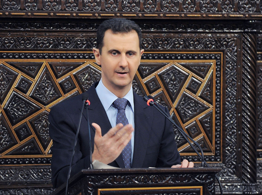 . Syrian President Bashar Assad delivers a speech at the parliament in Damascus, Syria on June 3, 2012. Israel launched an airstrike into Syria, apparently targeting a suspected weapons site, U.S. officials said Friday night, May 3, 2013. (AP Photo/SANA, File)