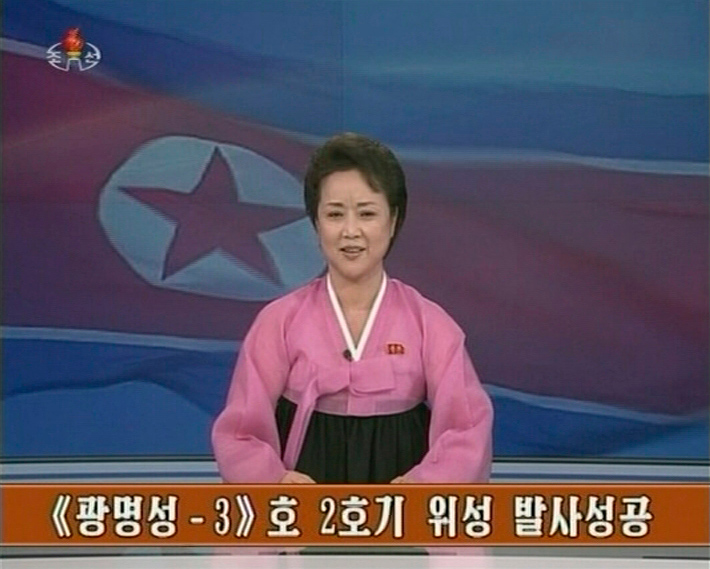 . A North Korean KRT TV presenter announces the successful launch of a long-range rocket by North Korea in this December 12, 2012, still image taken from TV. North Korea successfully launched the rocket on Wednesday, boosting the credentials of its new leader and stepping up the threat the isolated and impoverished state poses to its opponents. The rocket, which North Korea says was designed to put a weather satellite into orbit, has been labelled by the U.S., South Korea and Japan as a test of technology that could one day deliver a nuclear warhead capable of hitting targets as far as the continental the United States.site. The words at the bottom of the still image is an announcement of the successful launch of the rocket. REUTERS/KRT via REUTERS TV