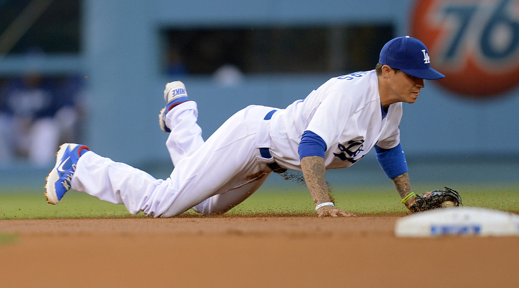 . Los Angeles Dodgers shortstop Justin Sellers makes a diving catch against the Colorado Rockies April 29, 2013 in Los Angeles, CA.  He was able to throw the runner out at first on the play.(Andy Holzman/Staff Photographer)