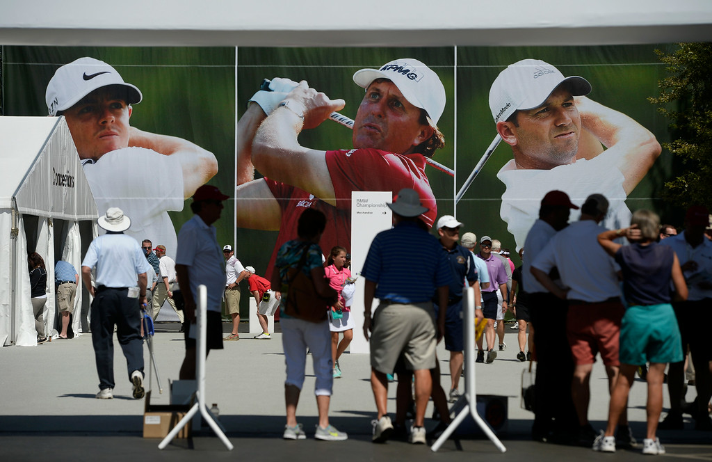 . CHERRY HILLS VILLAGE, CO. - SEPTEMBER 02:  Golf fans enter the grounds to the likeness of golfers, Rory McIIroy, left, Phil Michelson, center, and Sergio Garcia, on the fence of the driving range at the FedExCup BMW Championship at the Cherry Hills Country Club Tuesday, September 02, 2014 (Photo By Andy Cross / The Denver Post)