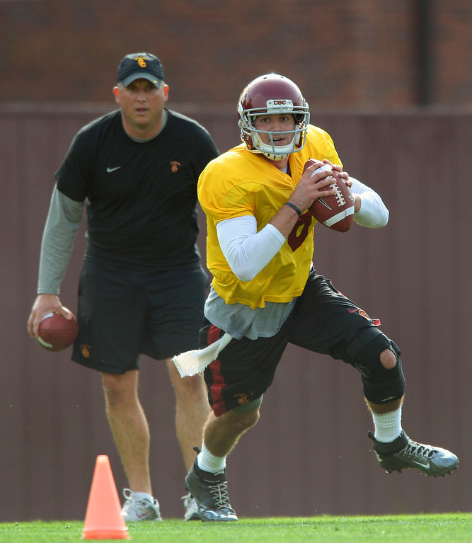 . USC QB Cody Kessler rolls out as quarterbacks coach Clay Helton watches during practice, Tuesday, March 25, 2014, at USC. (Photo by Michael Owen Baker/L.A. Daily News)