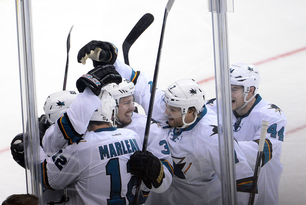 . San Jose Sharks left wing Matt Nieto is mobbed by teammates after scoring against the Los Angeles Kings during the second period in Game 4 of an NHL hockey first-round playoff series at Staples Center in Los Angeles on Thursday, April, 24  2014.  (Keith Birmingham Pasadena Star-News)