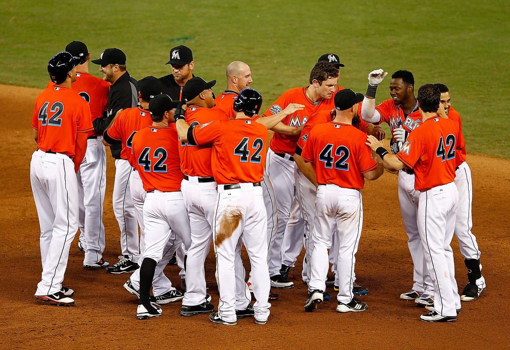 . Hanley Ramirez of the Miami Marlins celebrates hitting a bases loaded walk off single in the 11th inning during a game against the Houston Astros at Marlins Park on April 15, 2012 in Miami, Florida. Both teams wore the number 42 in honor of Jackie Robinson Day.  (Photo by Mike Ehrmann/Getty Images)