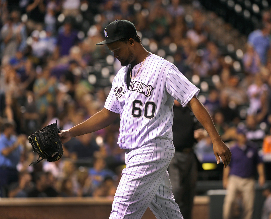 . DENVER, CO. - SEPTEMBER 4: Colorado reliever Manny Corpas walked off the mound after striking out Yasiel Puig in the eighth inning. The Colorado Rockies defeated the Los Angeles Dodgers 7-5 at Coors Field Wednesday night, September 4, 2013.  Photo By Karl Gehring/The Denver Post