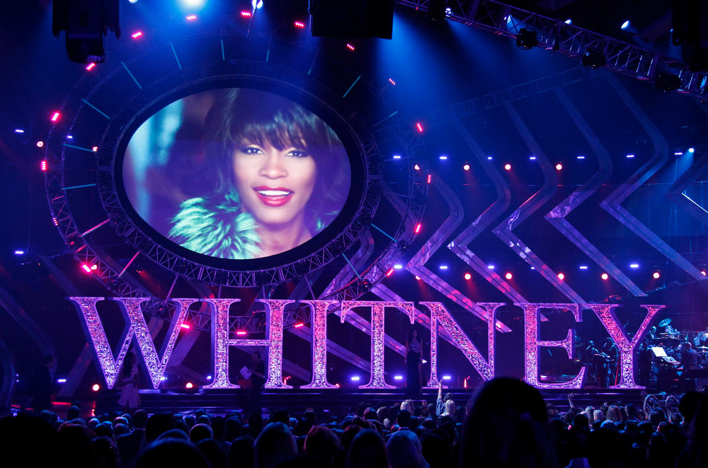 . A video pays tribute to singer Whitney Houston during the VH1 Divas 2012 show in Los Angeles, December 16, 2012. Whitney Houston was Google\'s number one most searched trending person and overall search term of 2012. REUTERS/Danny Moloshok