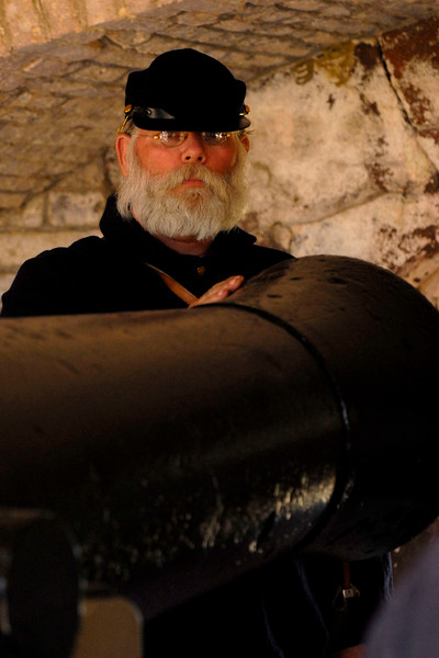 Reenactor Private Walter Evans stands in the #2 position at a canon in Ft. Sumter, located in Charleston Harbor, in Charleston, South Carolina on Wednesday, April 13, 2011. ..The 150th Anniversary of the Firing on Ft. Sumter was commemorated with lectures, performances, demonstrations, and a living history throughout the area on James Island, Charleston, Mt. Pleasant, and Sullivan's Island during the week from April 8-14, 2011. Photo Copyright 2011 Jason Barnette