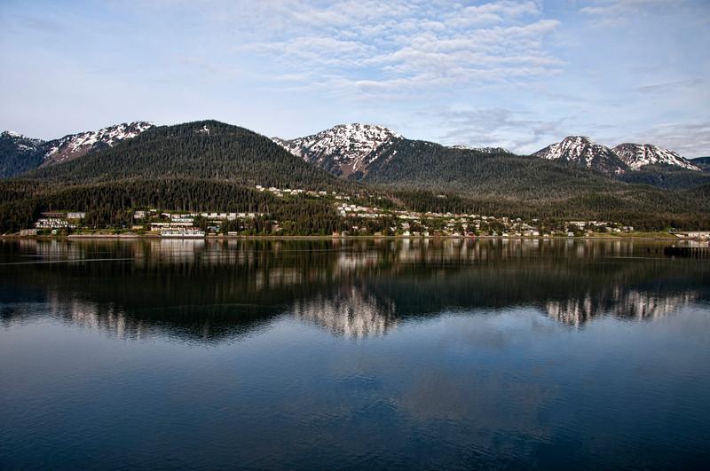 Juneau, Alaska reflected in the waterway.