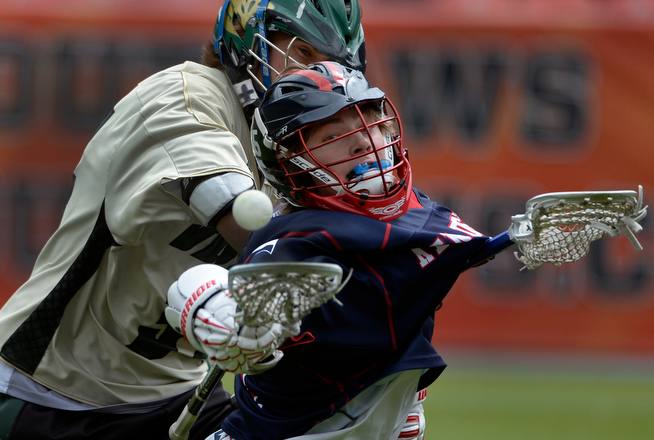 . Kent Denver\'s Ryan Weiss, right, and Mountain Vista\'s Hunter McGeeney fight for control of the ball as they move down the field. Kent Denver takes on Mountain Vista in boys lacrosse at Sports Authority Filed at Mile High stadium on Saturday, April 19, 2014. (Kathryn Scott Osler, The Denver Post)