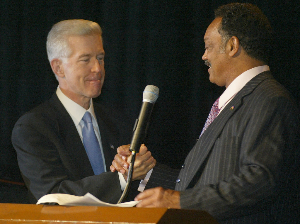. California governor Gray Davis shakes hands with the Rev. Jesse Jackson at the Rainbow/PUSH Annual Awards Dinner Thursday, Oct. 9, 2003, in Los Angeles. Davis was on hand to wish the Rev. Jaskson a happy 62nd birthday and comment on Tuesday\'s election. (AP Photo/Chris Carlson)