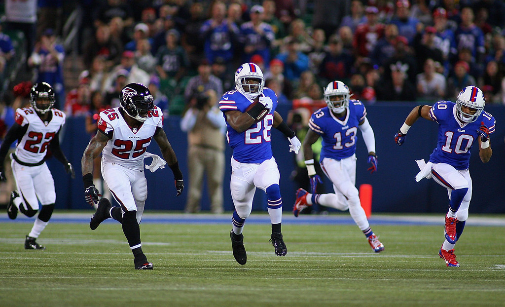. C.J. Spiller #28 of the Buffalo Bills runs for 77 yards against the Atlanta Falcons in the first half at Rogers Centre on December 1, 2013 in Toronto, Ontario.  (Photo by Rick Stewart/Getty Images)