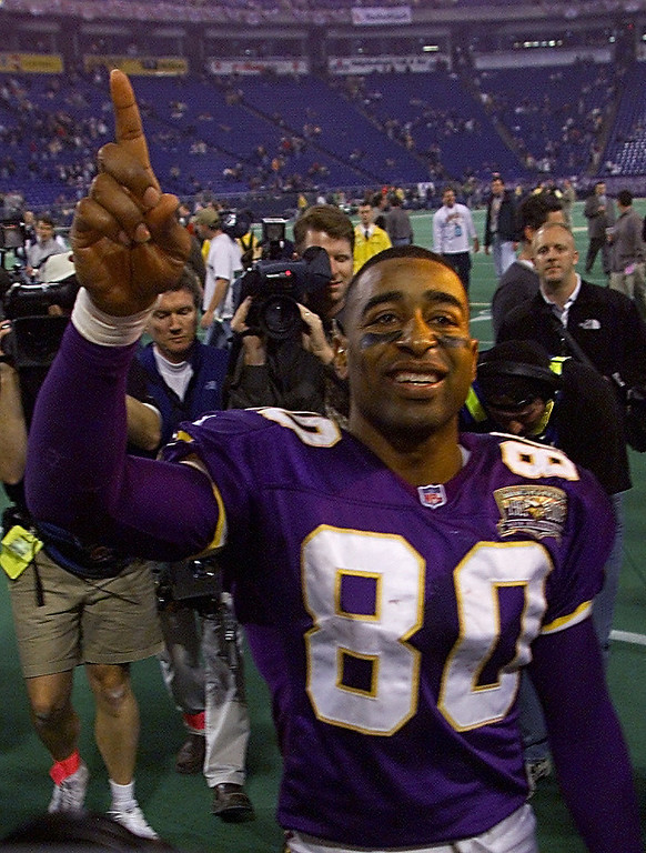. 06 Jan 2001:  Wide receiver Cris Carter #80 of the Minnesota Vikings celebrates after defeating the New Orleans Saints at the Metrodome in Minneapolis, Minnesota.   The Vikings won 34-16 to advance to the NFC Championship.  Mandatory Credit: Brian Bahr/ALLSPORT