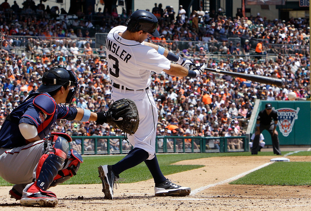 . Detroit Tigers\' Ian Kinsler singles against the Minnesota Twins in the second inning of a baseball game in Detroit, Sunday, June 15, 2014. (AP Photo/Paul Sancya)