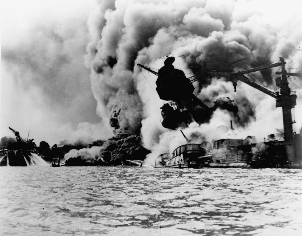 . This photo shows the Japanese attack on Pearl Harbor on December 7, 1941.  The USS Arizona is pictured in flames after the attack.  (AP Photo/U.S. Navy)