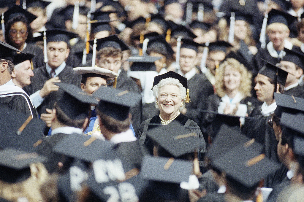 . First Lady Barbara Bush, center, is all smiles while being greeted by graduates at St. Louis University, Saturday, May 19, 1990, St. Louis, Mo. Mrs. Bush gave the commencement address to the 1,488 graduate and was later given an honorary doctor of humanities degree by the university. (AP Photo/James A. Finley)