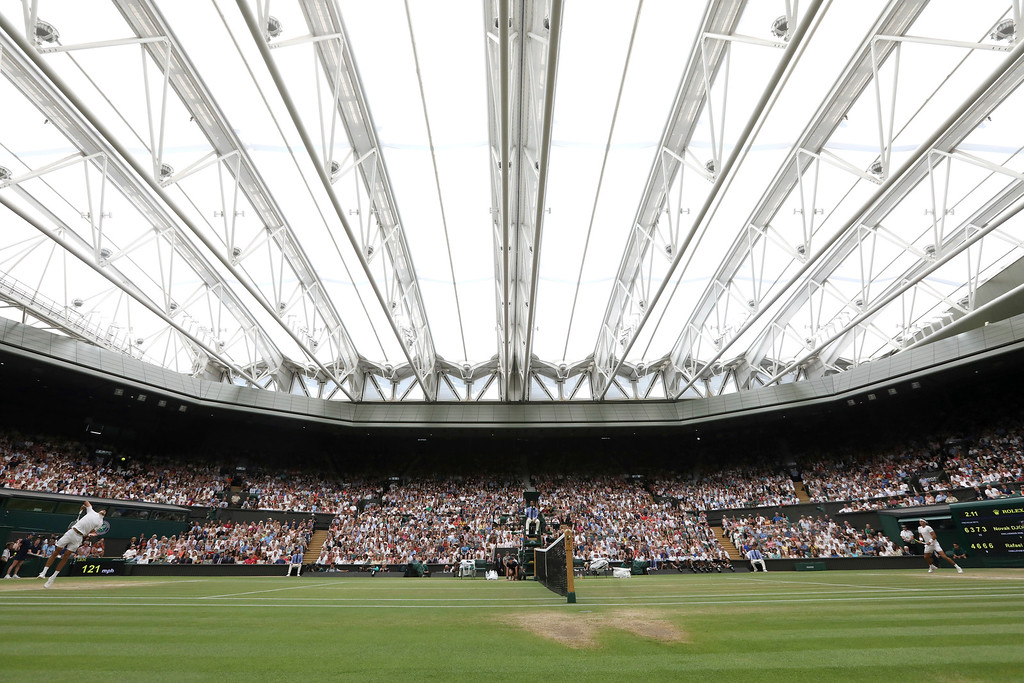 . Serbia\'s Novak Djokovic, left, serves to Rafael Nadal of Spain during their men\'s singles semifinals match at the Wimbledon Tennis Championships, in London, Saturday July 14, 2018.(AP Photo/Tim Ireland)