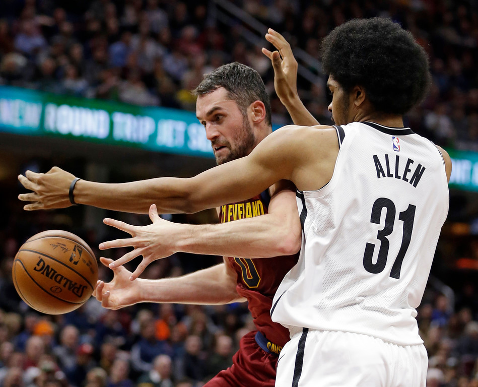 . Cleveland Cavaliers\' Kevin Love, left, loses the handle on the ball as Brooklyn Nets\' Jarrett Allen defends during the second half of an NBA basketball game, Wednesday, Nov. 22, 2017, in Cleveland. The Cavaliers won 119-109. (AP Photo/Tony Dejak)