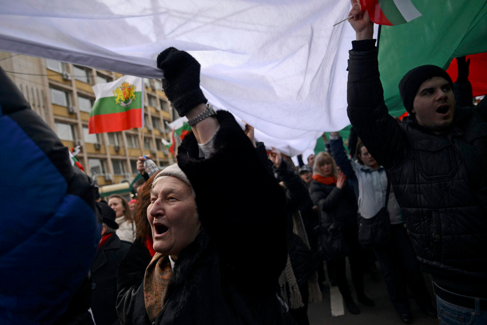 . People shout slogans as they block traffic during a protest against high electricity bills in Sofia February 17, 2013. Tens of thousands of Bulgarians protested in more than 20 cities against high electricity bills on Sunday, piling pressure on the government after a week of persistent demonstrations.  REUTERS/Tsvetelina Belutova