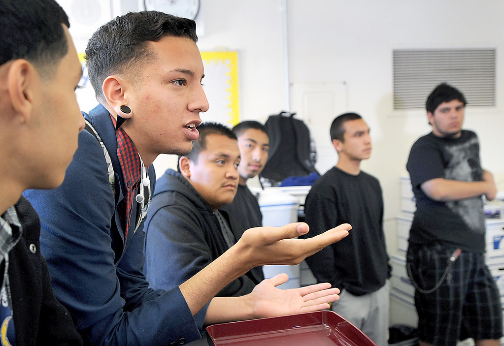 """. Juan Ibarra, a 12th grade student at Nueva Vista asking a question during a meeting with the Superintendent of Bassett Unified. The Bassett Unified School Board at Thursday�s meeting will discuss relocating its Nueva Vista High continuation/alternative school back to the Bassett High campus in the 2013-14 school year in order to provide a more cohesive learning environment.  School board member Laura Santos is opposed to the plan since the district spent $1 million to renovate the Nueva Vista campus. It�s unclear what would become of that site. Santos held a  rally with parents and students who oppose the move  Wednesday, April 17, 2013. .\""""Along with losing an excellent superintendent and terminating an award winning choir and music program, Santos sees this as part of a series of recent bad decisions,\"""" Santos said (SGVN/Photo by Walt Mancini)"""