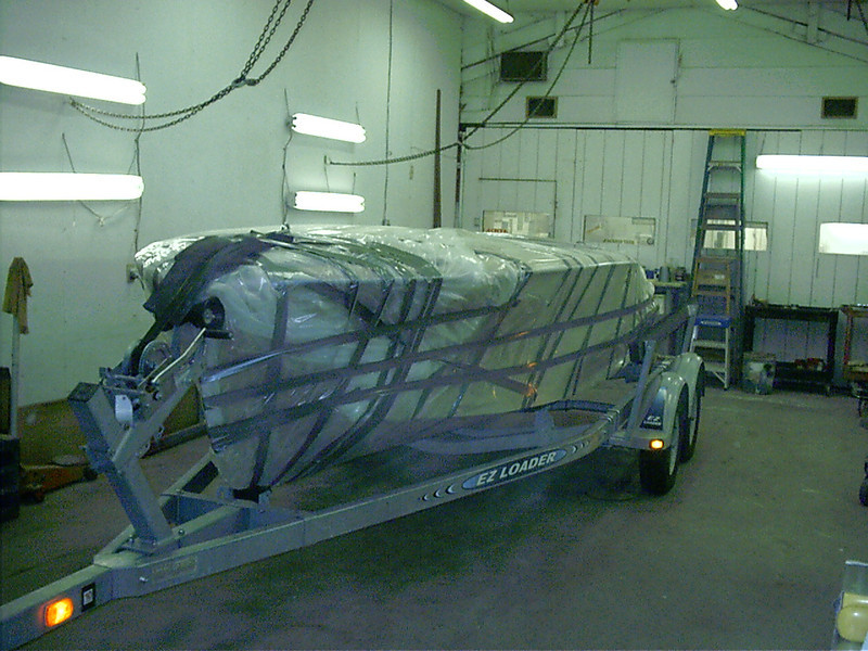 Another view of boat leaving for finish shop.