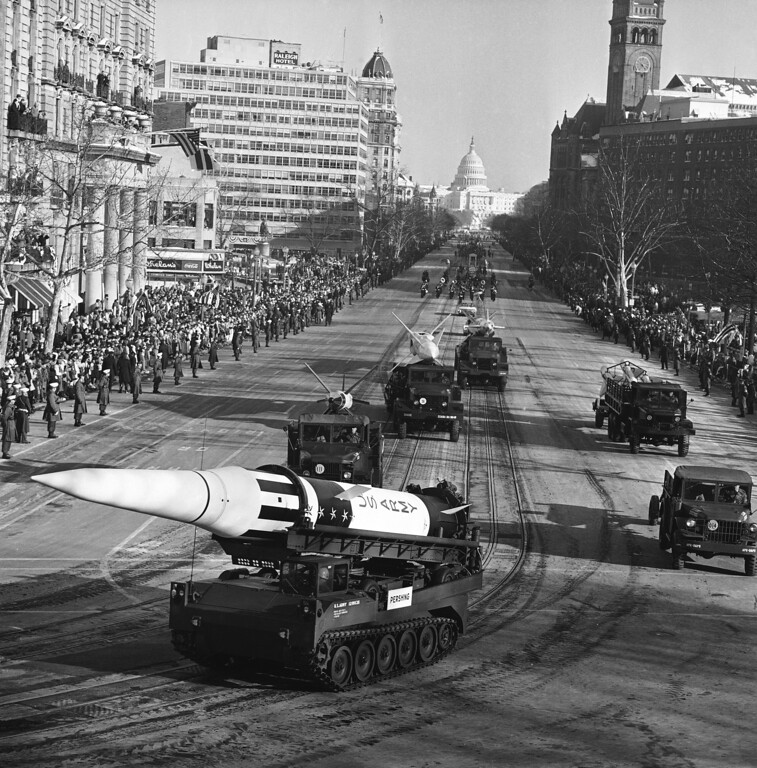 . An Army Pershing missile mounted on a tank-like carrier catches the sunlight as the inaugural parade for President John F. Kennedy draws attention of spectators along Pennsylvania Avenue in Washington, Jan. 20, 1961. Other missiles, from front, are: Lacrosse, Nike Hercules and Nike Zeus. This view toward the Capitol was made from a stand at the Treasury Department. (AP Photo)