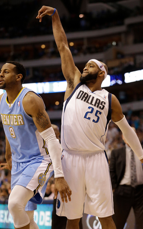 . Dallas Mavericks shooting guard Vince Carter (25) reacts to hitting a three point basket against Denver Nuggets shooting guard Andre Iguodala (9) during overtime play of an NBA basketball game on Friday, April 12, 2013, in Dallas. The Mavericks won 108-105.  (AP Photo/LM Otero)