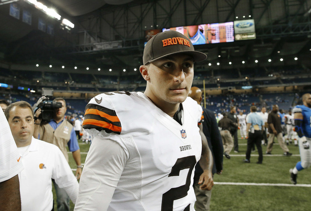 . Cleveland Browns quarterback Johnny Manziel (2) walks off the field after losing to the Detroit Lions 13-12 in the a preseason NFL football game at Ford Field in Detroit, Saturday, Aug. 9, 2014. (AP Photo/Rick Osentoski)